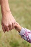 parent-holds-hand-child-small-30602637